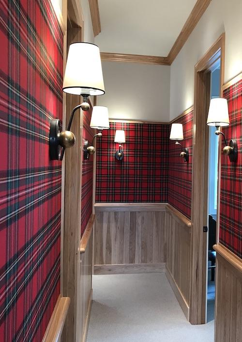 red tartan covers corridor walls
