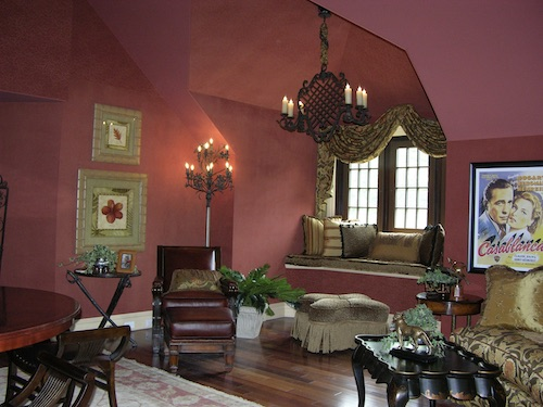 sitting room with a banquette window and red walls