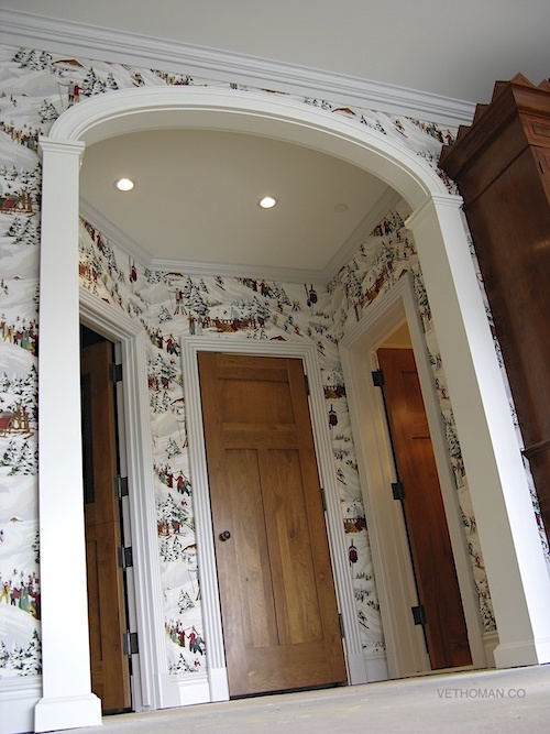 small entrance to main room upholstery in printed fabric on walls