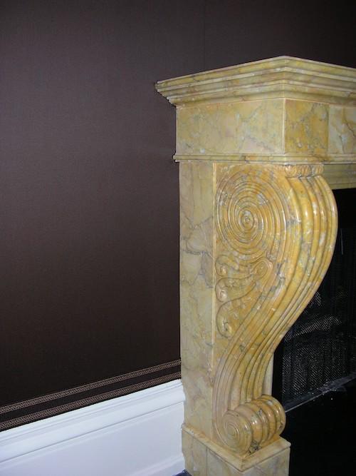 brown fabric around a stone fireplace
