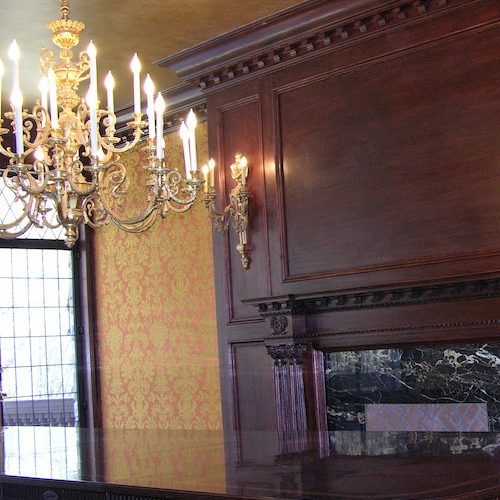 upholstered damask panels with wood panels and chandelier
